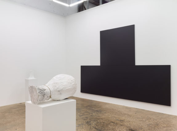 Large black painting and plaster head