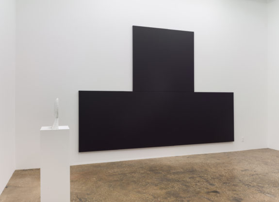 Large black painting in gallery