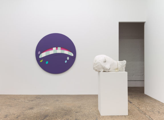Purple circular painting and white plaster bust in gallery