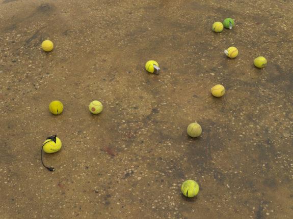 Tennis balls on floor