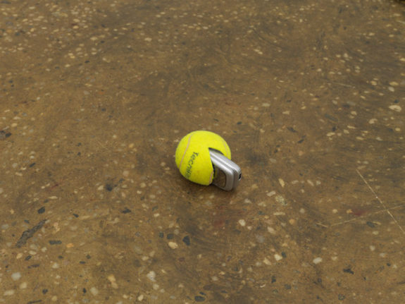 Tennis ball with cell phone inside of it