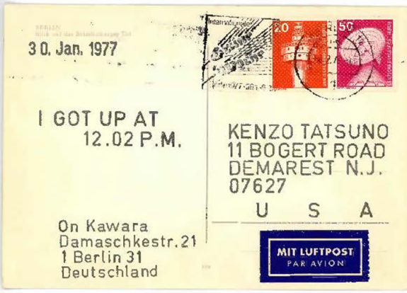 Back of postcard with stamps