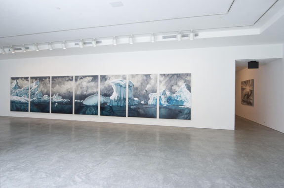 Seven panel painting of the ocean in gallery space