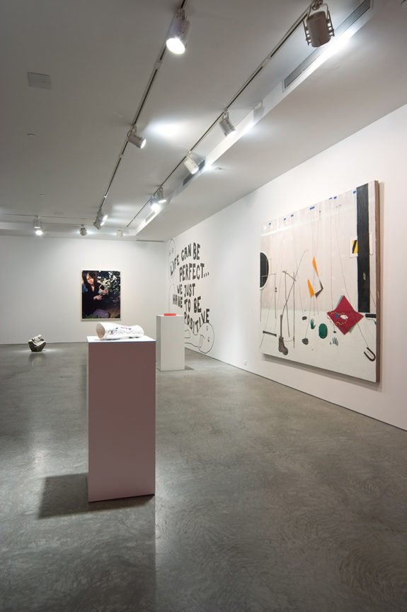 paintings and sculptures inside gallery