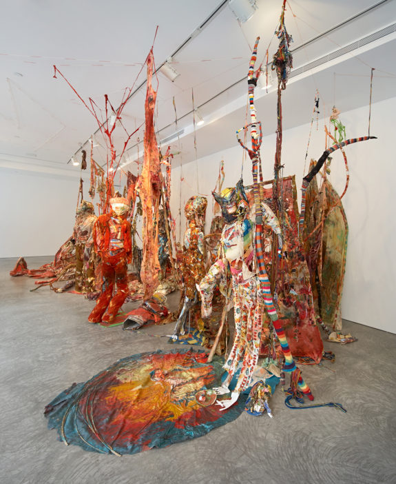Large red sculpture in gallery