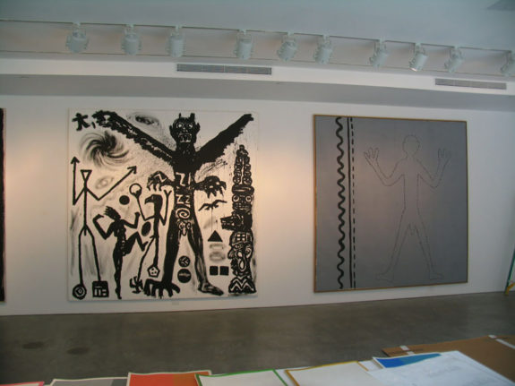 Large paintings of figures in gallery