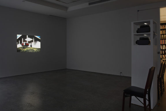 dark room with small projection on wall