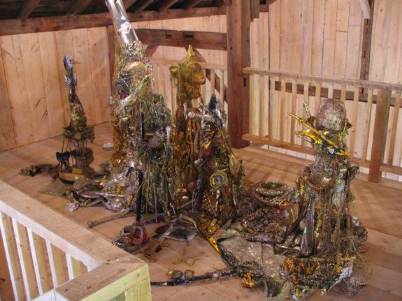 sculptures inside barn
