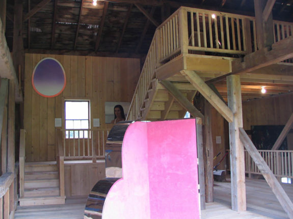 view of pink sculpture and paintings inside barn