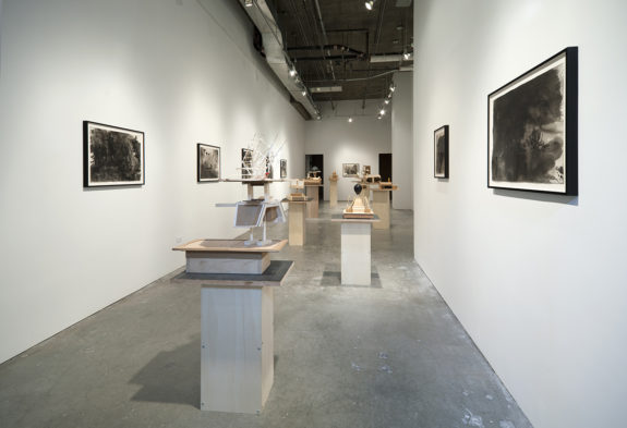 sculptures and paintings inside gallery
