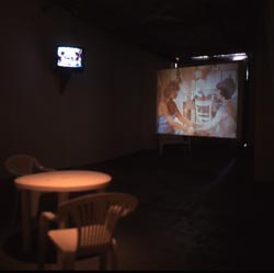 table and chairs, video projection