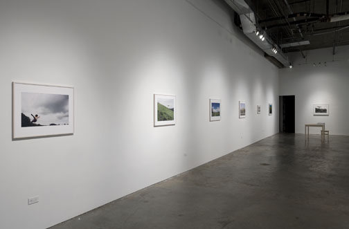 Long gallery space with framed photographs