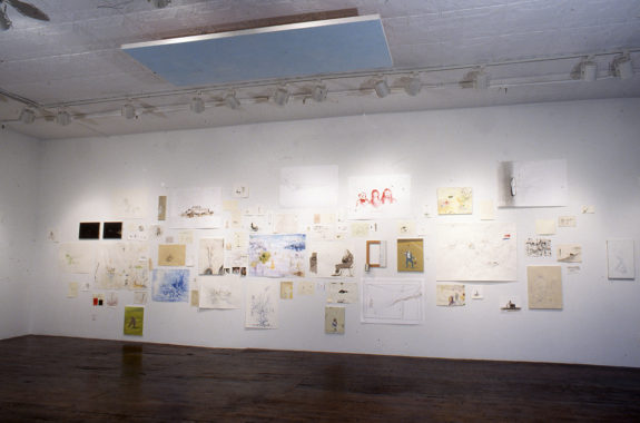 Gallery with many drawings on the wall