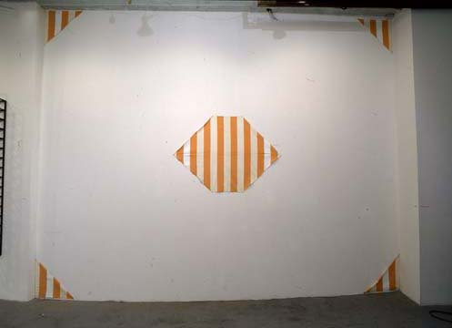 orange and white stripes on gallery wall