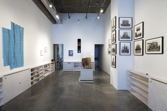 paintings and shelves in gallery