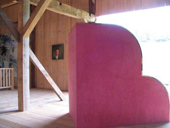 pink sculpture inside barn