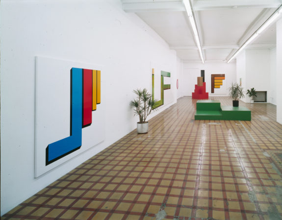 Bright geometric sculptures on wall