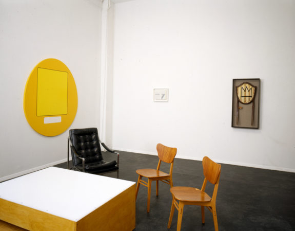 Sculptures and chairs in gallery