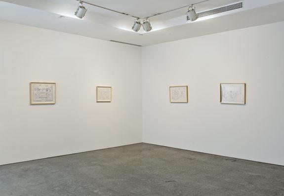 Framed drawings in gallery
