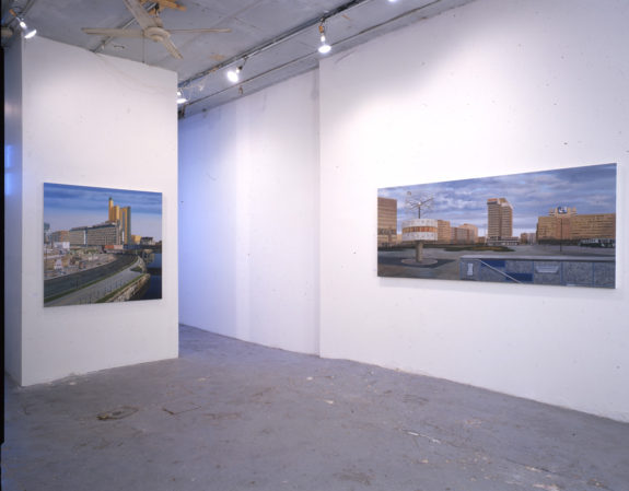 Large photographs of cities in gallery