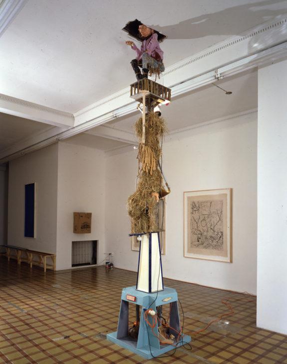 Large wooden sculpture in room