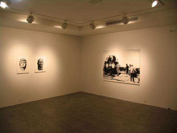 Black and white portraits in gallery