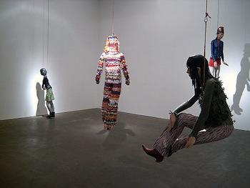 Sculptures of people in gallery
