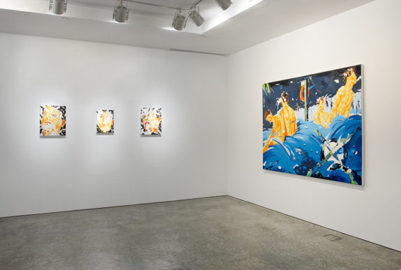 Two small paintings and one large painting in gallery space
