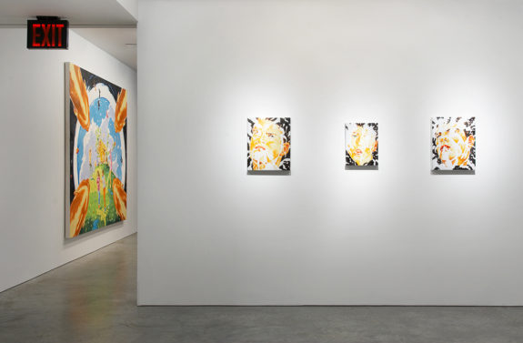 one large and three small paintings in gallery space