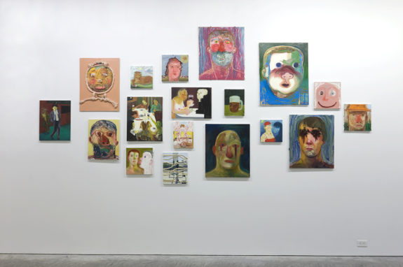 grouping of medium sized of paintings on a wall