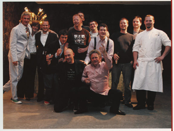 Chefs and others in a group portrait