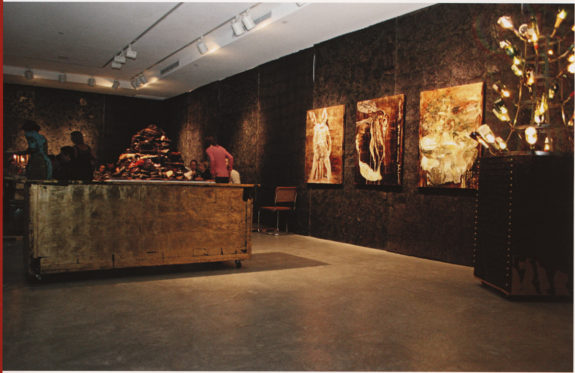 Dark gallery with gold table