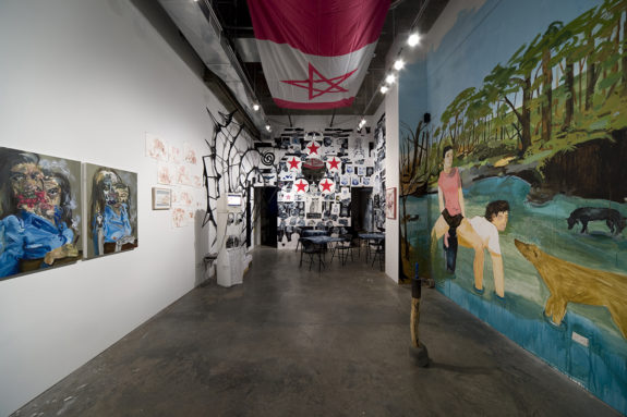 paintings and mural in gallery