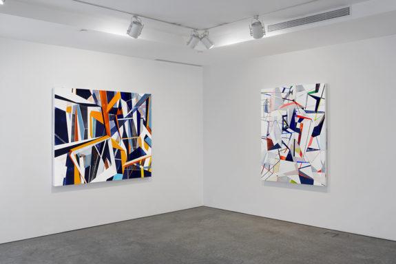 Geometric paintings in gallery