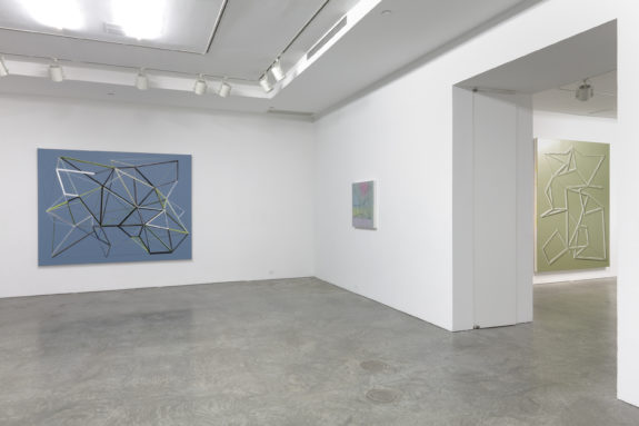 geometric paintings in gallery