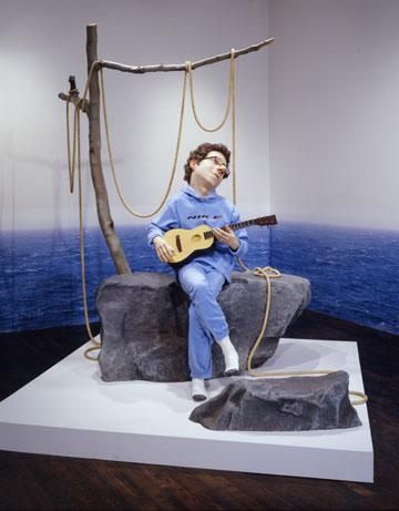 man playing ukelele