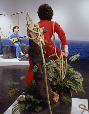 man in red outfit standing in a plant