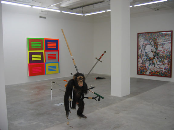 Sculpture of monkey and swords in gallery