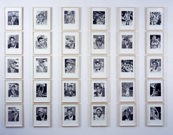 36 black and white portraits framed