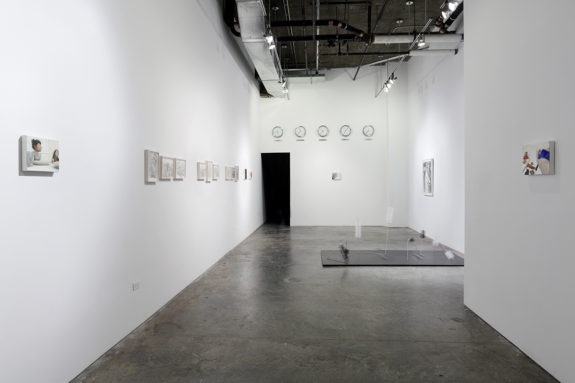 paintings and sculpture in a gallery
