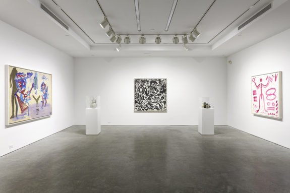 paintings in a gallery and sculptures on pedestals