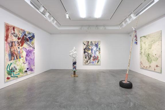 sculptures and paintings in gallery