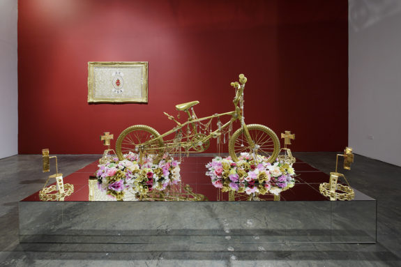 sculpture of a gold bike with flowers