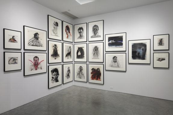 paintings in corner of gallery