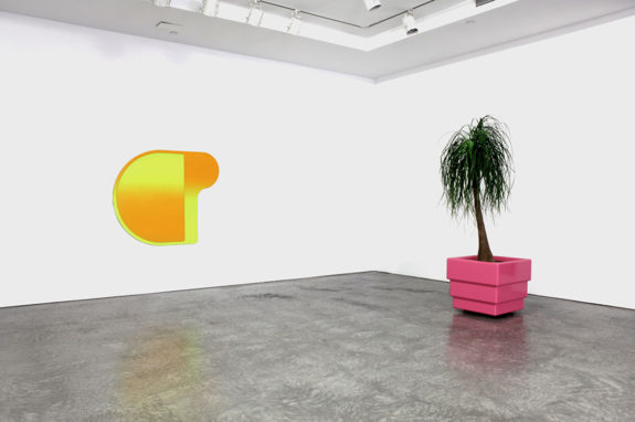 painting and tree sculpture in gallery