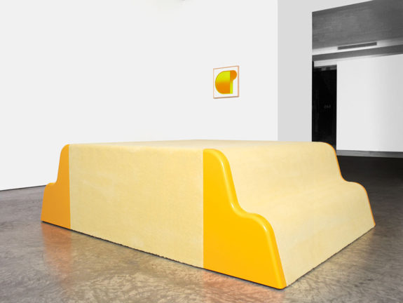 large yellow sculpture and small painting in gallery