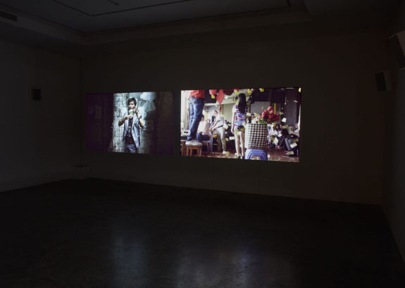 projected video in dimly lit gallery