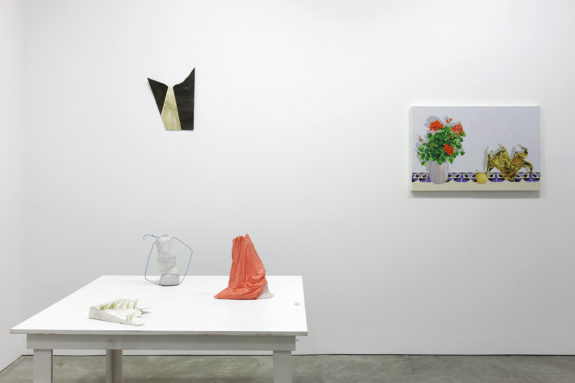 paintings and sculptures in a gallery