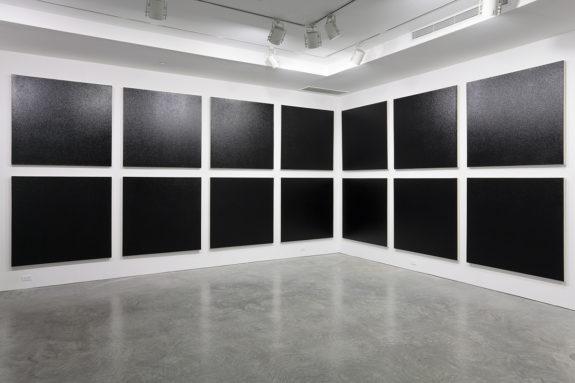 black paintings in a gallery