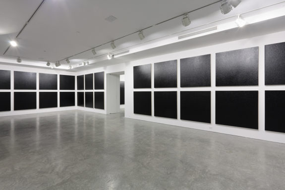 black paintings in a gallery